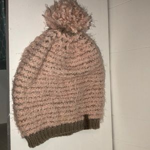 Pink and tan beanie with puff on top